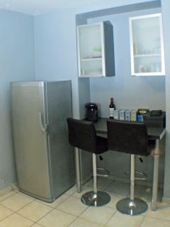 Fridge and breakfast bar/preparation area