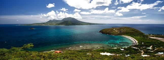 View of Beautiful Turtle Beach. Coral reefs visible in foreground & Nevis in the background.