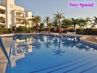 Beautiful large Swimming Pool which is also very private with apts to one side and golf course views
