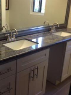 Remodeled Bath with Full Wall Mirror and Double Vanities & Granite Counter Top