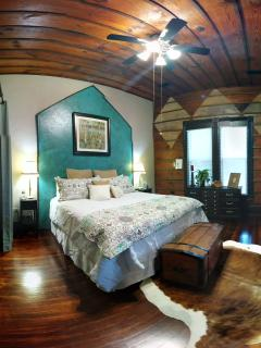 Master Bedroom- King Pillow Top Mattress with 12' Ceilings and Matching Wood Plank Walls and 32'TV