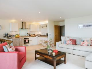 Open plan living, dining and kitchen area with deep comfy sofas