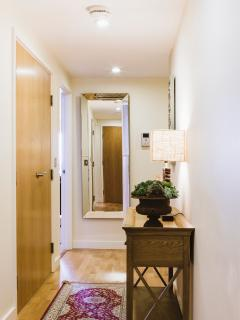 Bright and clean hallway leading to all rooms