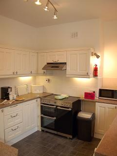 Well equipped kitchen, next to the dining room