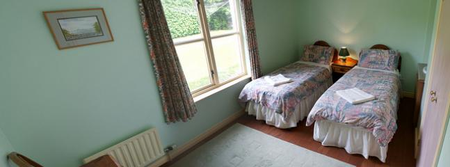 One of the twin bedrooms at Bearnagh Cottage at Tory Bush