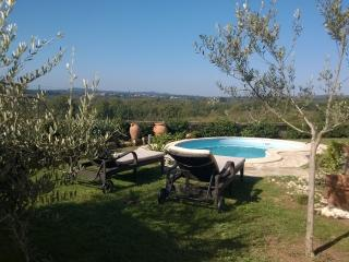 Pool with gardens, pergola and wisteria, wonderful views over countryside.