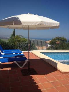 Large patio pool area with 6 sunbeds