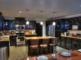 spacious kitchen fully loaded with appliances and cooking needs