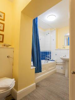 Separate bathroom with bath tub and overbath shower