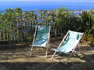 relax on private garden terrace with sea and sunset views