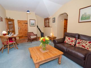 Open plan dining and relaxing area - with cosy woodburner
