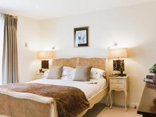The master bedroom with king size bed and ensuite bathroom