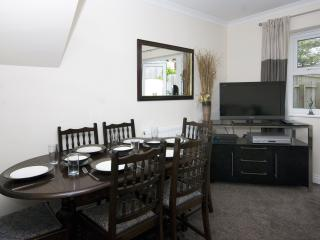 an extending dining table with 6 chairs provides enough room for eating in or enjoying a takeaway