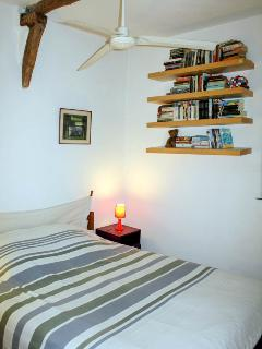 Bedroom with king sized bed and books to read!