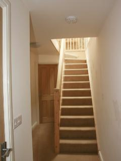 Stairs to upper floor open plan living space