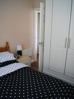 Master bedroom with 15inch thick Mattress, walk in wardrobes, side table with reading lamp and draws