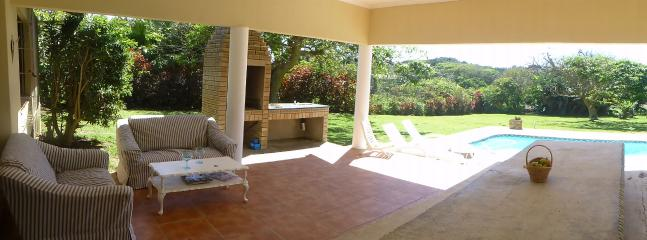 Patio with stove dining table, outside lounge and braii