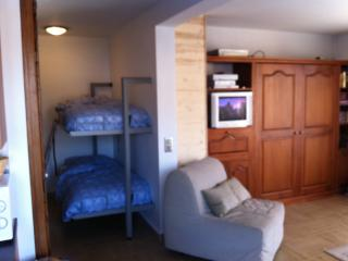 Sleeping areas - bed folds out of the wall.  Bunks fold away. TV and Sky available.