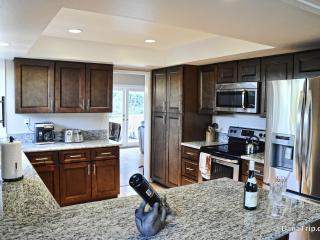Fully upgraded gourmet kitchen with top of line appliances, utensils and cutlery