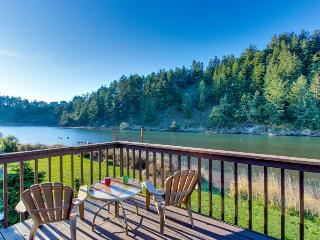 Dog-friendly riverside cottage with backyard firepit & kayak launch!