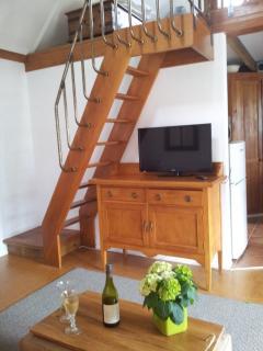 Cottage staircase to mezzanine bedroom