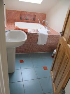 Attic Bathroom with insulated Japanese deep soaking bath.  Perfect for salt bath soaking.,
