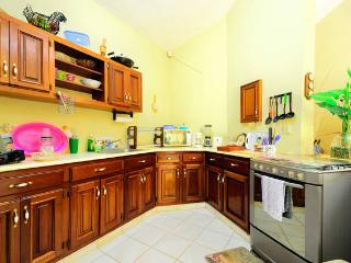 Fully equipped kitchen with cook ware, microwave, toaster, coffee maker, glasses, cutlery and dishes