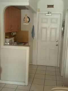Kitchenette and front door of unit