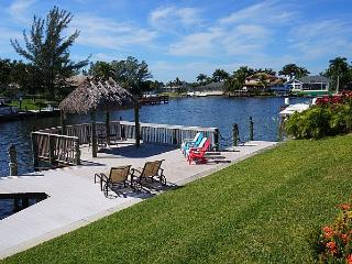 Villa Blue Water - Cape Coral 4b/3ba luxury home w/electric heated pool/spa, gulf access canal, HSW Internet, Boat Dock w/Rental Boat + Tiki Hut