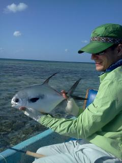Anlger with a nice permit landed