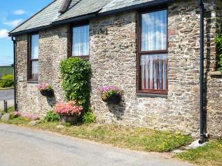 PRIMROSE COTTGE, barn conversion, single-storey, peaceful location, close to