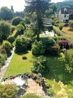Rear garden views with outdoor terrace seating