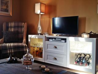 Neutrals keep the room clean and inviting despite a wearth of furniture and some high tech devices.