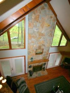 Enjoy the view of the awesome 2 story fireplace and the lake from the landing.