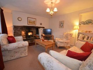 Lounge with feature fireplace and wood burner