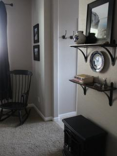 Cozy up in the rocking chair next to the electric fireplace