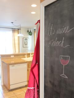 Our custom chalkboard greets you as you enter the kitchen