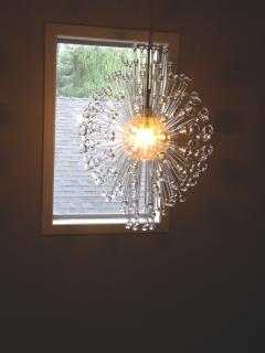Chandelier from bottom of stairs.