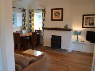 The Cowshed living room has underfloor heating as well as a wood burner.