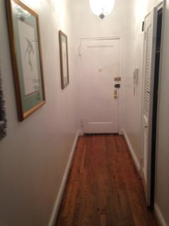 LONG HALLWAY WITH AMPLET CLOSETS