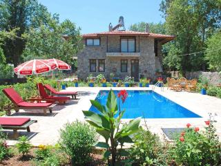 Stone villa in Kayakoy with well groomed garden, Fethiye