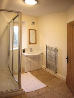 The en-suite for the superking room with large shower enclosure.
