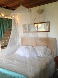 Luxury linens adorn this romantic bedroom