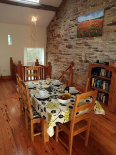Our dining area and wooden staircase.