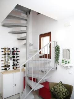 Welcoming entrance hall with 'wine cellar and stairs to first floor