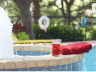 beat the heat with a cold drink and a dip in the pool!