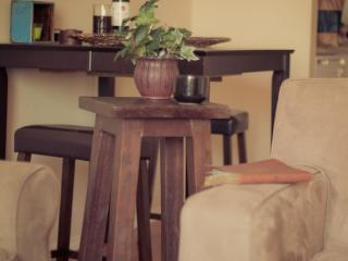 Crate and Barrel Axis arm chair is great with a book and a cup of coffee