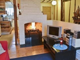 Living/dining room towards kitchen. Open log fire, satellite TV, DVD, CD & wifi available