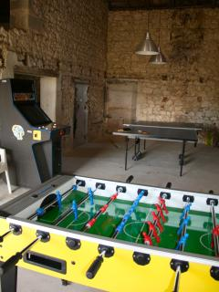 Fabulous games room for all ages with bikes and toys and books and DVDs...