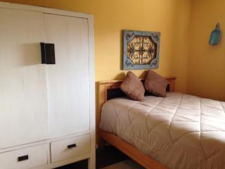 2nd bedroom with queen bed,  antique import wardrobe and nice touches